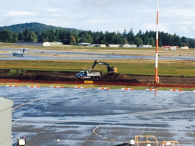 September 3 - Rooftop view of early days of construction on Apron IV Expansion.  The recent rain creating a challenging situation for the gravel trucks.