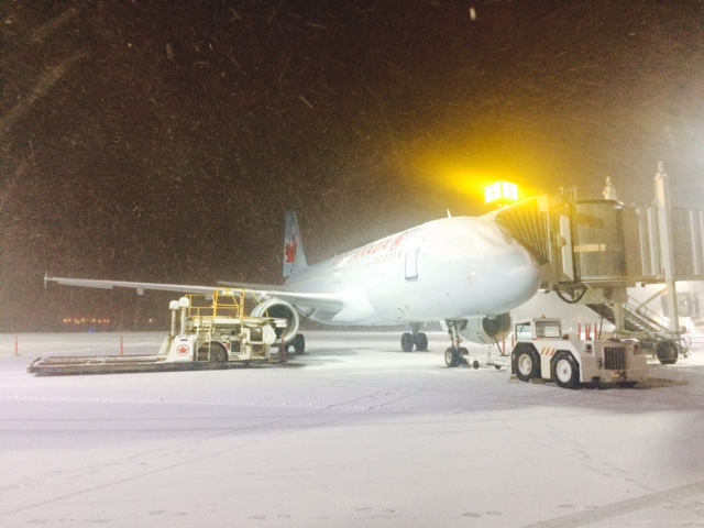 December - Air Canada A319 at Gate 9.  Early morning and still snow-covered.