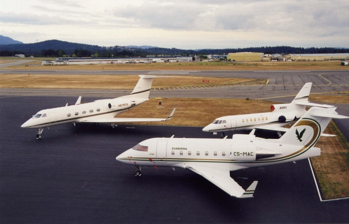 Three corporate jet aircraft parked at the Viking-Shell Aerocentre.