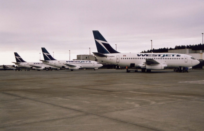 Three WestJet Airlines Boeing 737-200 aircraft on the main apron at Victoria International Airport.