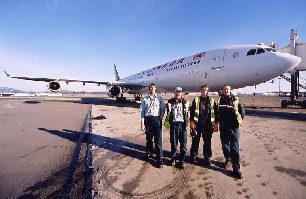 Air Canada A340 diverted to Victoria due to fog on November 29, 2002. The aircraft is shown here with Ramp Attendants (L-R) Steve Foggitt, Alan Coupland, Curtis Grober, and Hugh McCall.