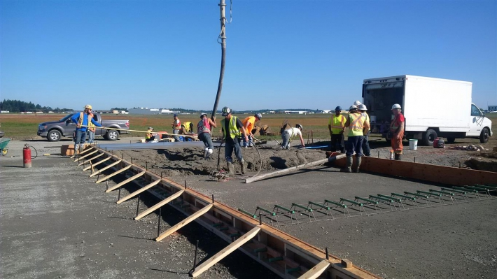 September 30 - Beginning of concrete pour for one of the aircraft parking stands.