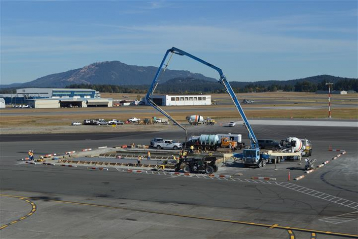August - Construction of concrete aircraft parking stands continues on Apron IV.