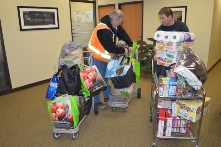 December - Airport Authority staff Jamie and Joe loading up goods collected for VIATEC Food Bank Challenge.