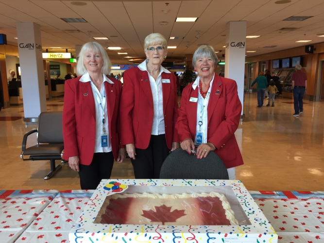 July - Canada Day.  Our Red Coat Volunteers handing out cake for travellers.
