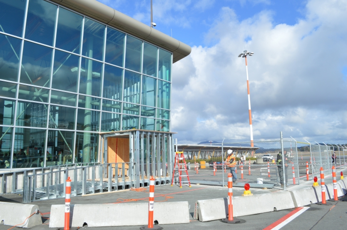 March - Construction fencing going up for Lower Passenger Departure Lounge Expansion.