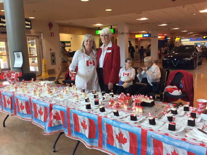 July - Our Red Coat Volunteers serving up Canada Day birthday cake.